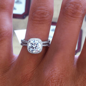 Showing Off Her New Custom Design Engagement Ring In The Jewelry Store