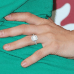 Woman With An Engagement Ring On Her Finger