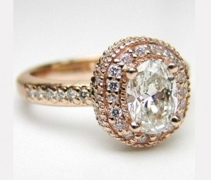 Picture of gold vintage antique engagement ring on display.