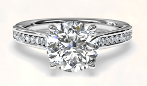 Beautiful engagement ring laying down by fine jewelry store.