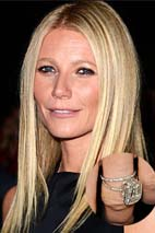 Gwyneth Paltrow smiling with smaller picture of custom diamond ring