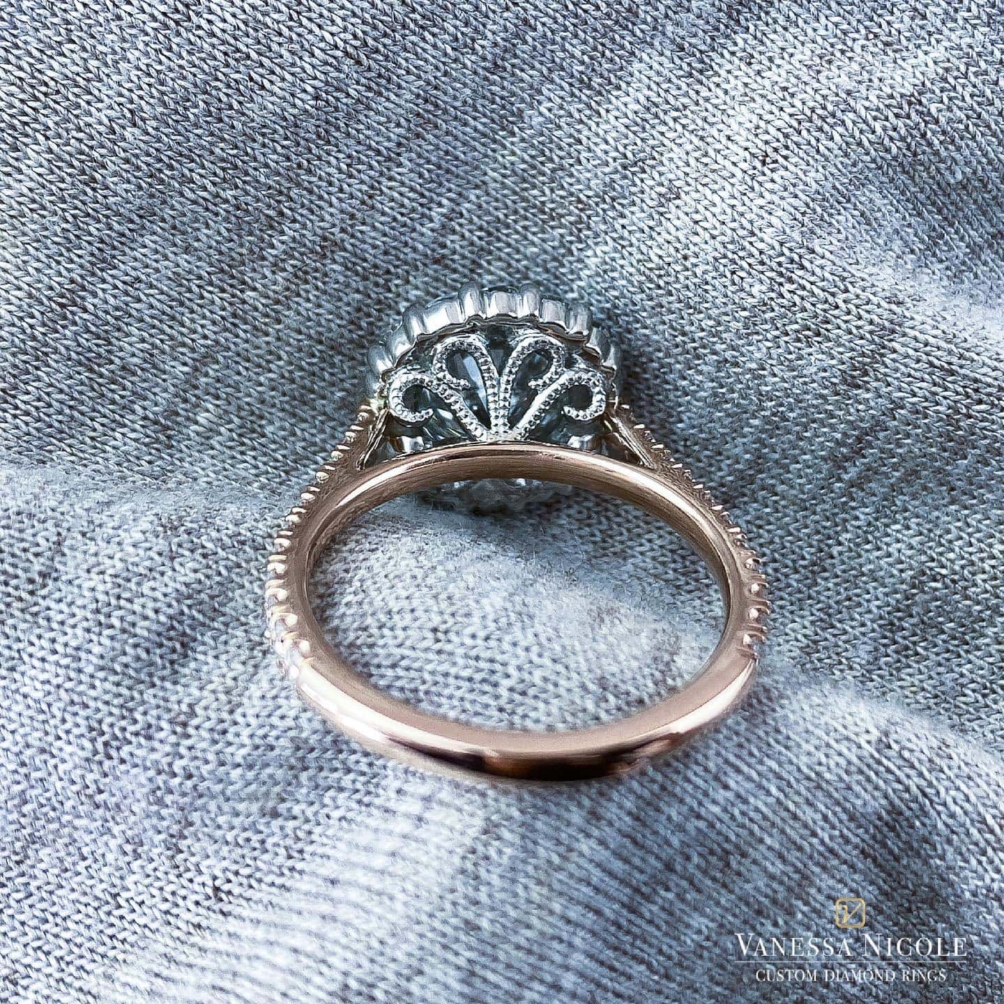 back view of round brilliant diamond in halo micro pave antique style rose gold setting