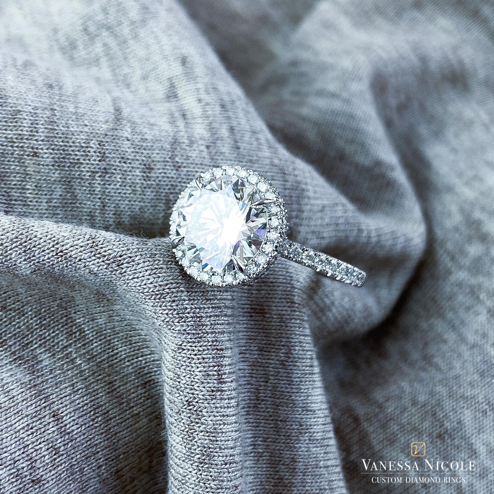 brilliant round cut diamond in platinum micro pave halo setting