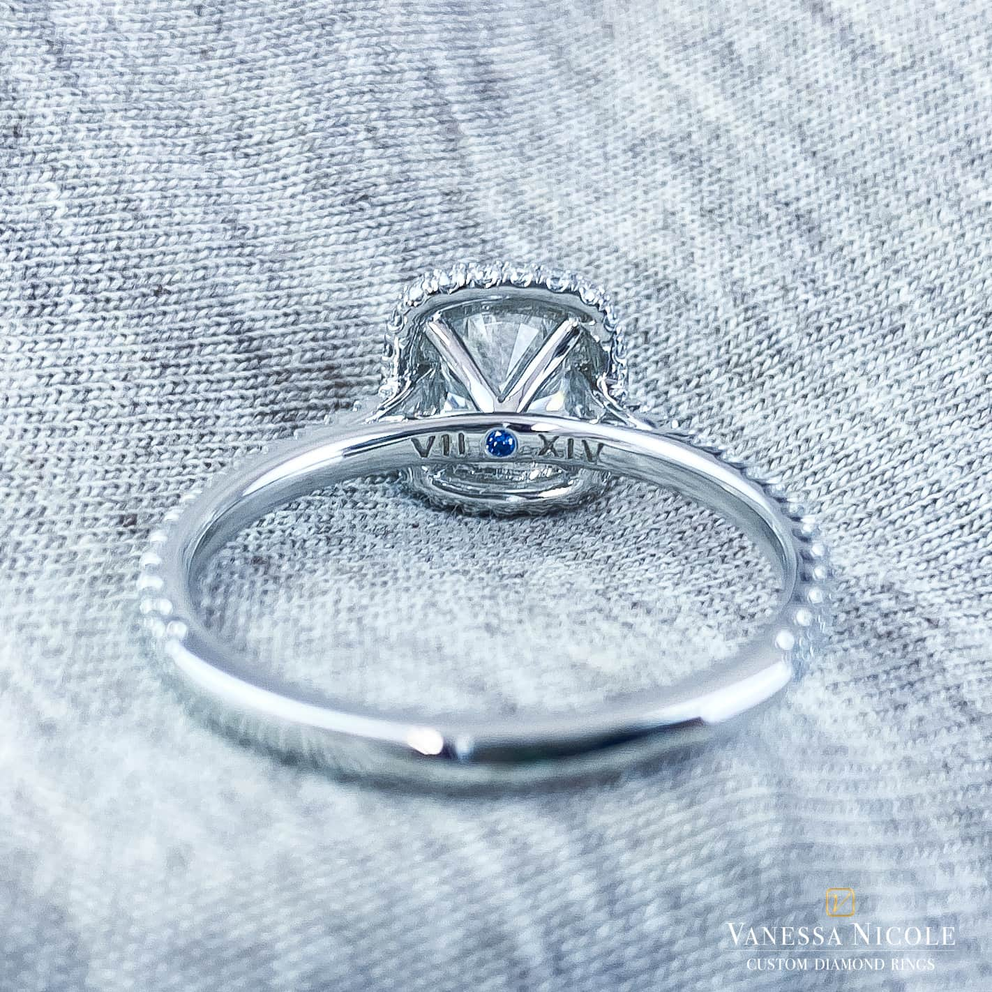 back view of cushion cut diamond in platinum micro pave halo setting