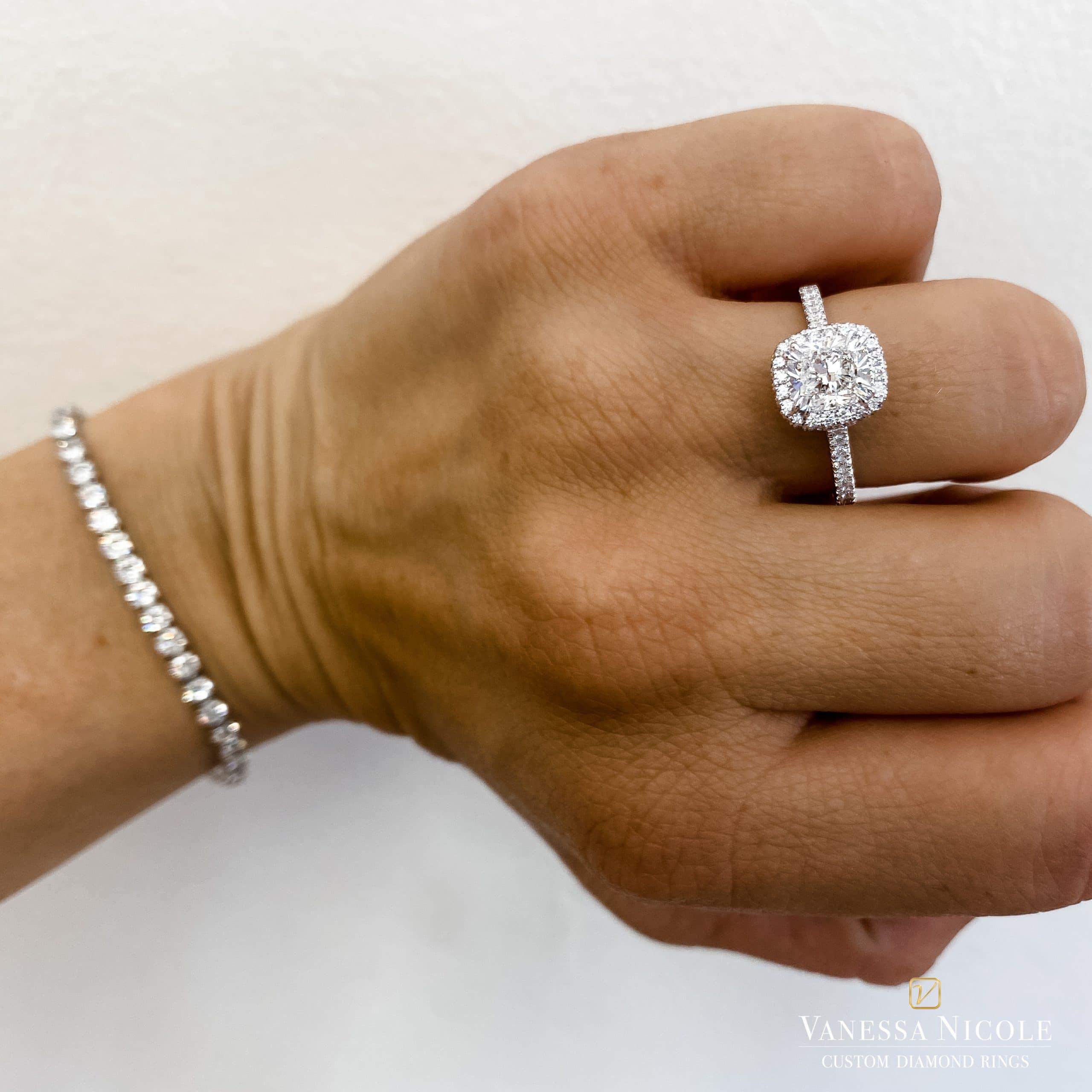 cushion cut diamond in platinum halo micropave setting