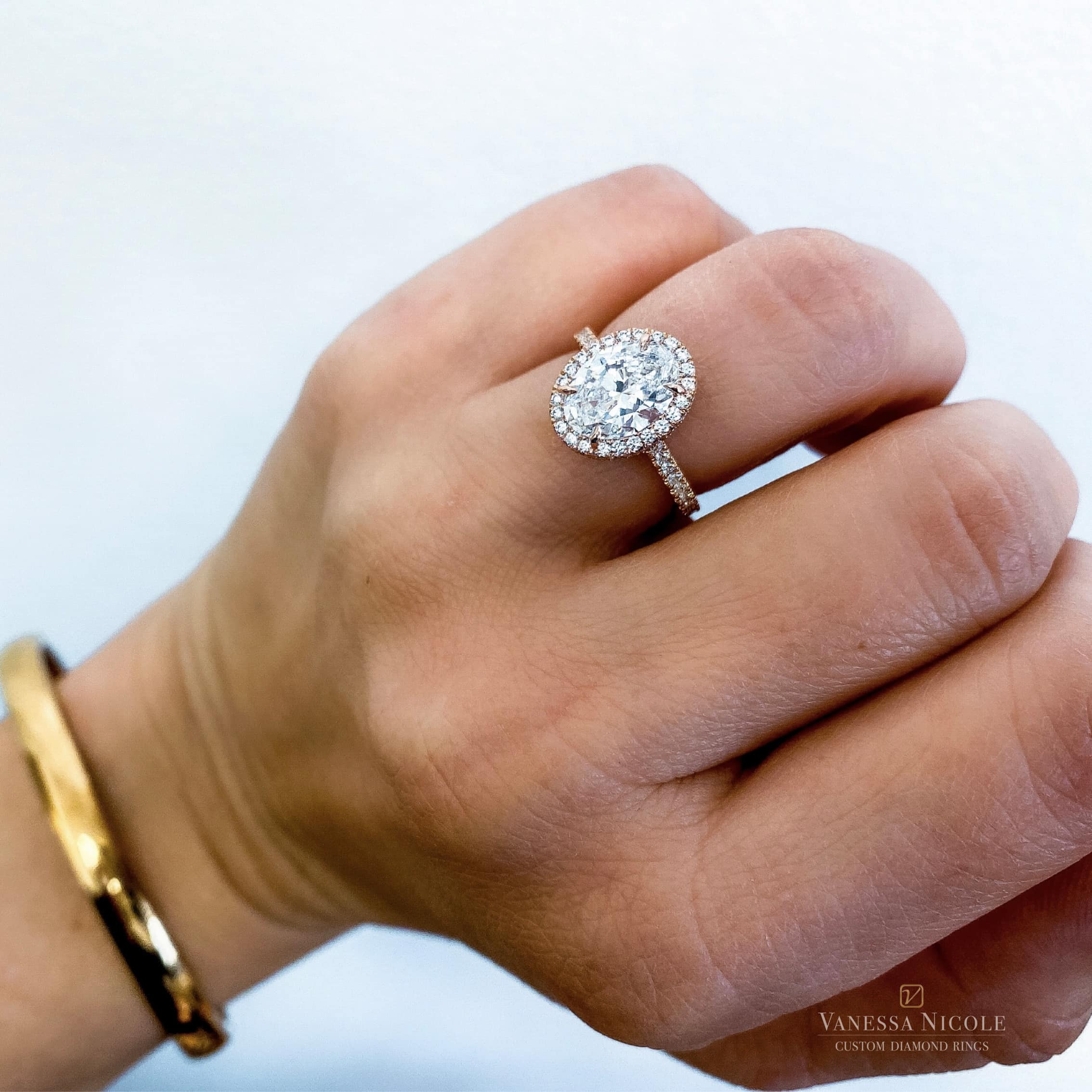 oval cut diamond in micro pave gold setting