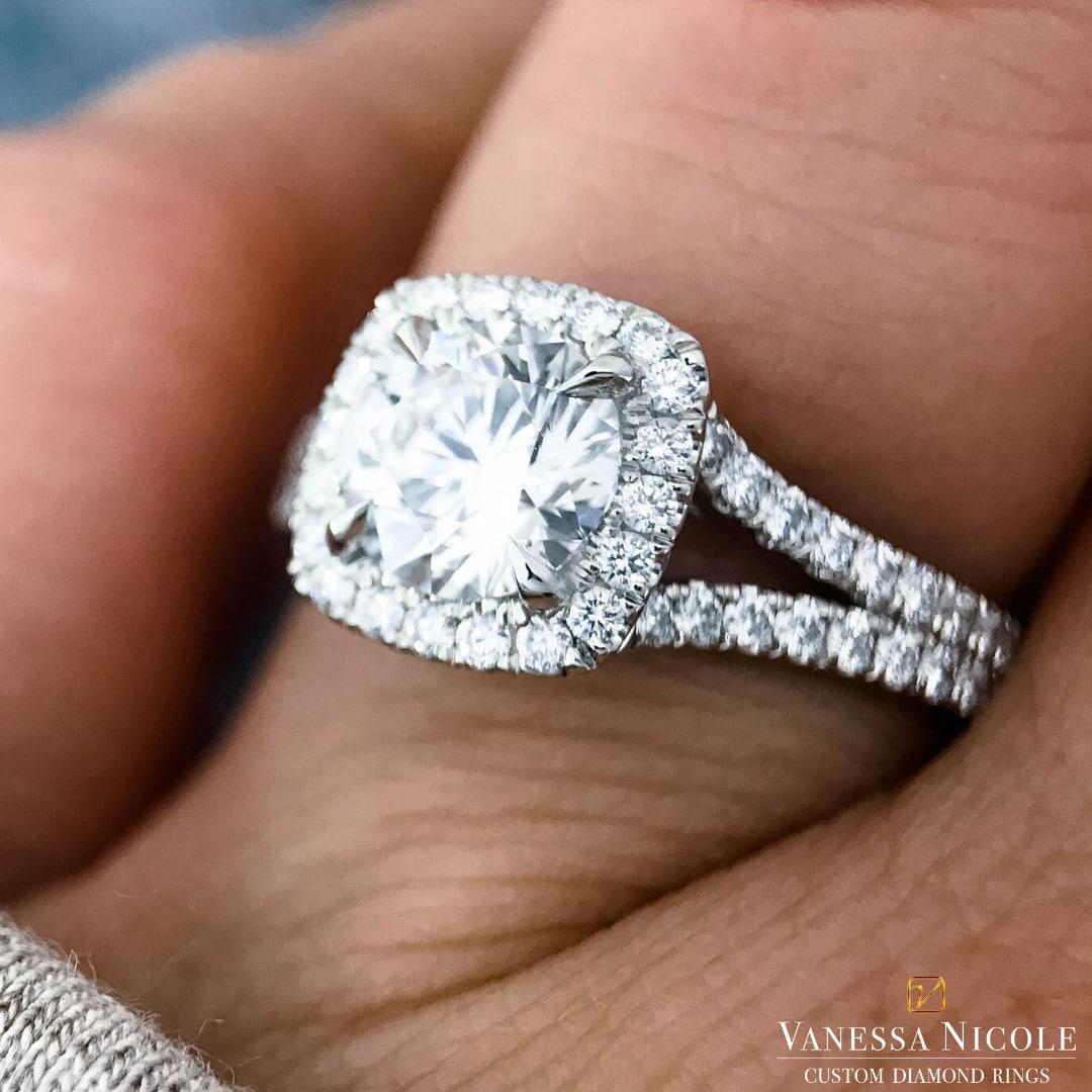cushion cut diamond in white gold halo setting