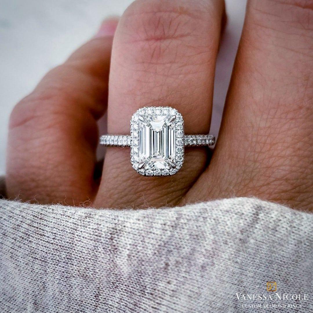 emerald cut diamond with platinum halo micropave setting